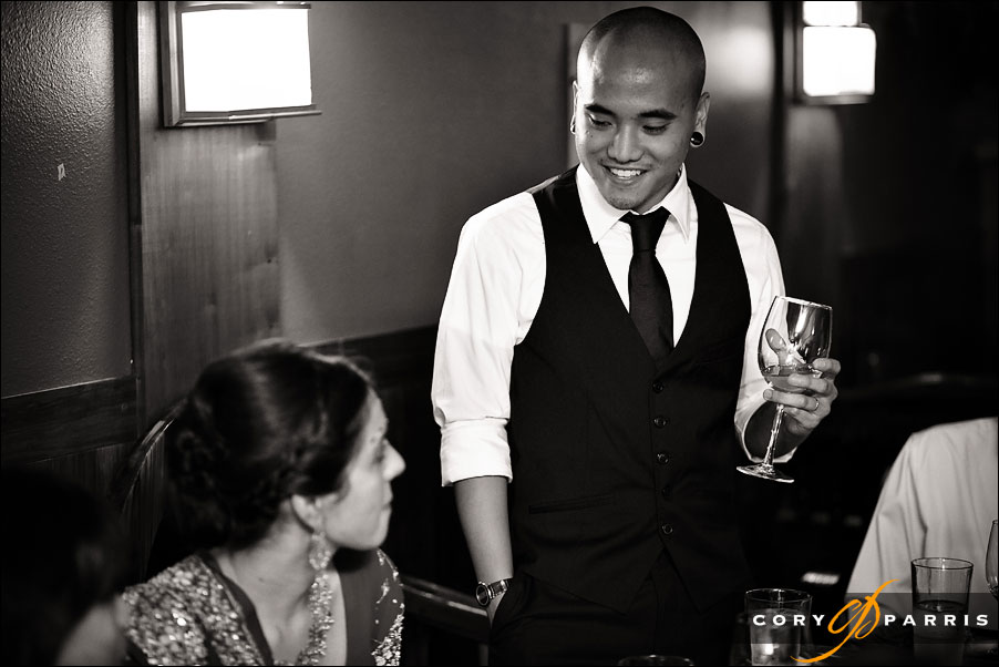 groom toasting the bride by seattle wedding photojournalist cory parris