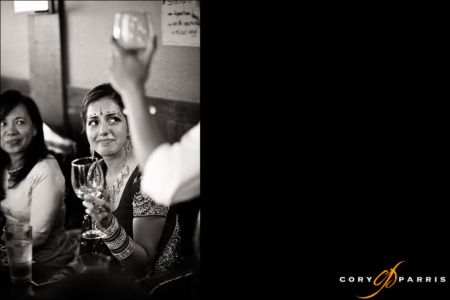bride crying during toast by seattle wedding photojournalist cory parris