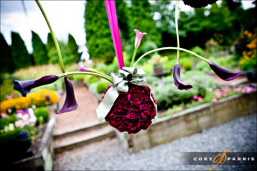 hanging flower arrangement in red and pink by seattle wedding photographer cory parris