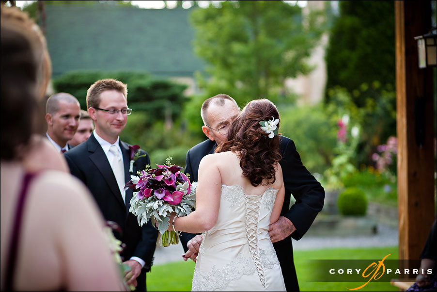 dad giving away the bride at willows lodge wedding by photographer cory parris