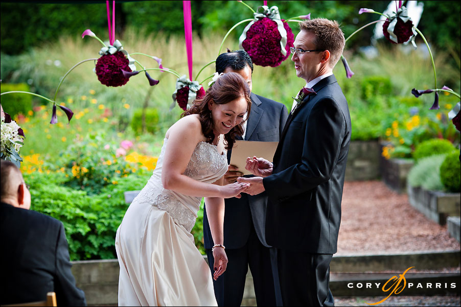 bride and groom laughing during wedding at willows lodge by seattle wedding photojournalist cory parris