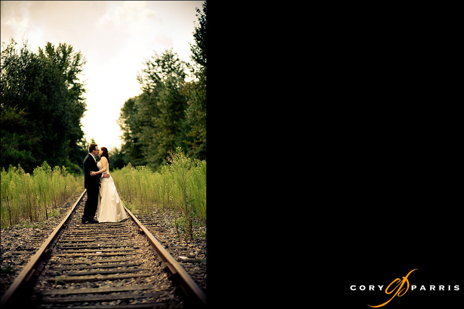 bride and groom on railroad tracks by seattle wedding photographer cory parris