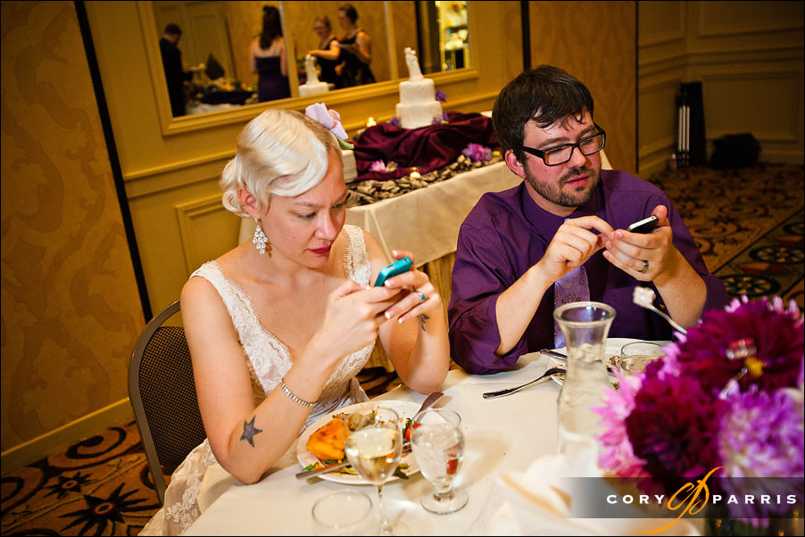 bride and groom updating their facebook status by seattle wedding photojournalist cory parris
