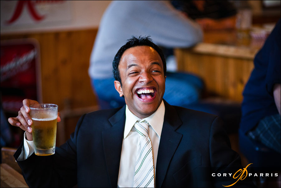 wedding officiant laughing and drinking a beer by seattle wedding photojournalist cory parris