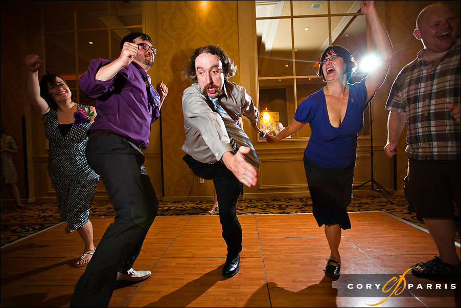 wedding guest and groom dancing at the hotel deca by seattle wedding photojournalist cory parris