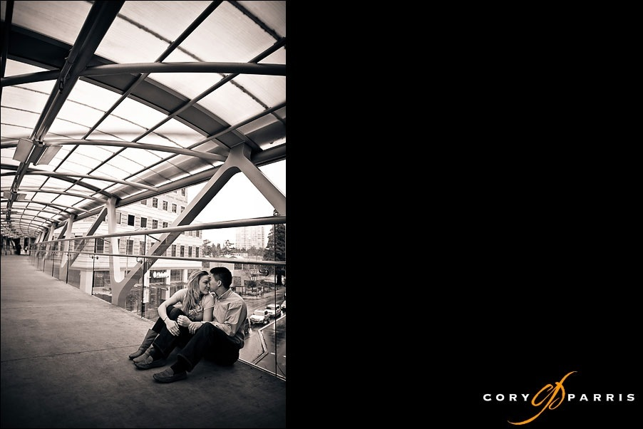 portrait of a couple on a skybridge in downtown bellevue by photographer cory parris