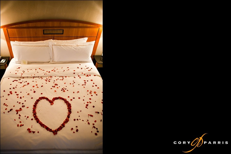bed of rose petals at hotel bellevue by seattle wedding photographer cory parris
