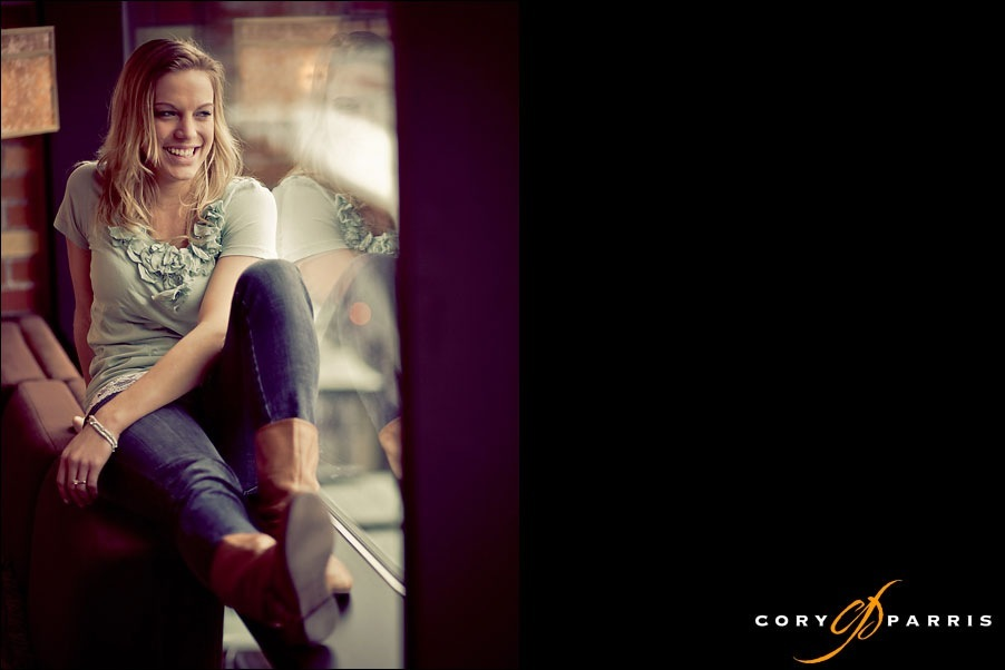 laughing woman in the window by seattle portrait photographer cory parris