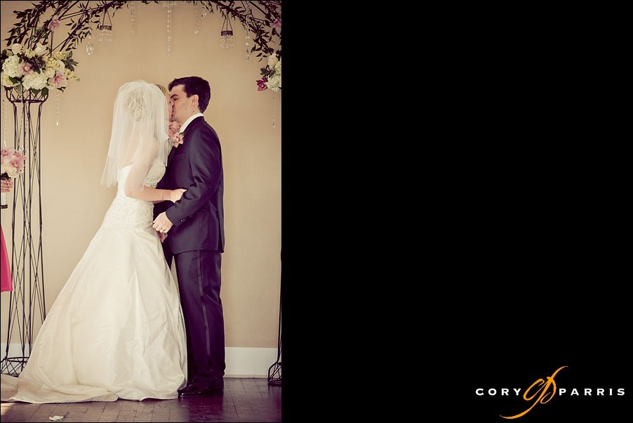 bride and groom kissing during ceremony at heritage hall in kirkland