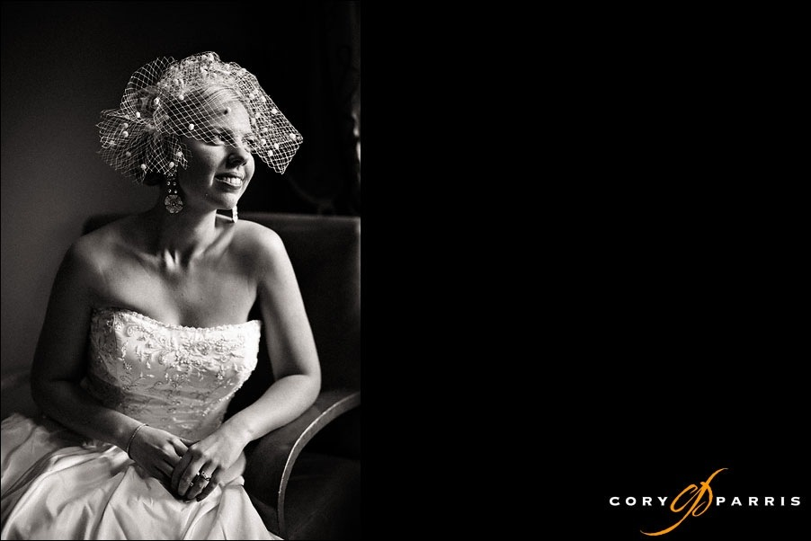 bride by window light at hotel bellevue by seattle wedding photographer cory parris