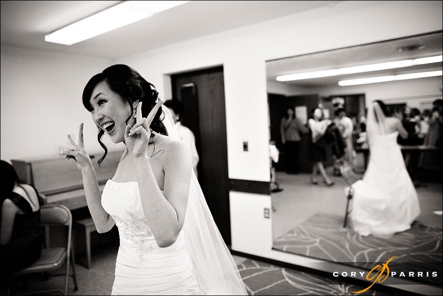 bride showing the peace sign by seattle wedding photographer cory parris