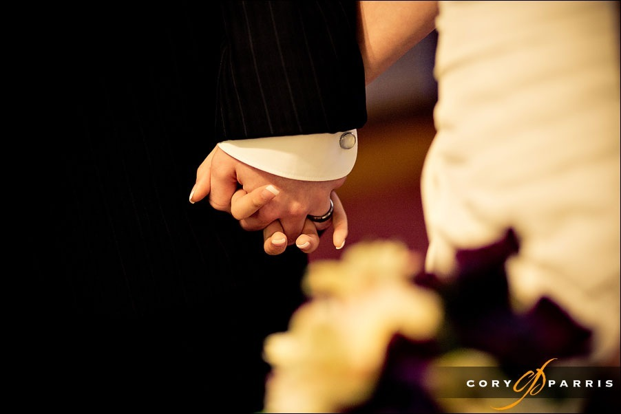wedding couple holding hands by seattle wedding photojournalist cory parris