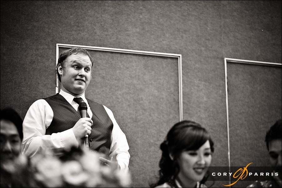 groomsman toasting the bride and groom by seattle wedding photojournalist cory parris