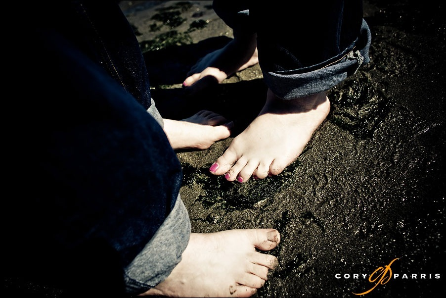 engagement portrait with wet toes on the beach