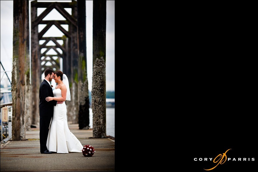 bride and groom on the dock at the everett yacht club by photographer cory parris