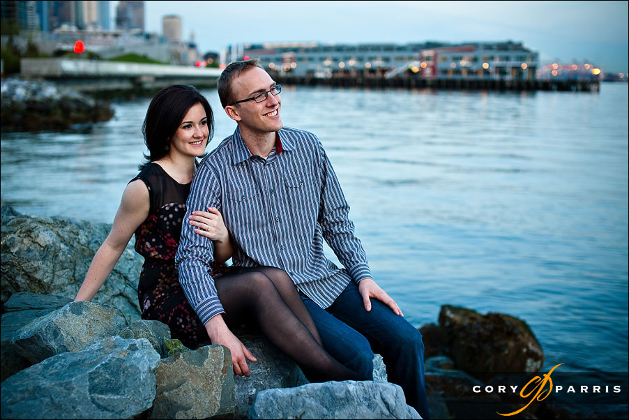 engagement portrait at the seattle waterfront with the puget sound behind