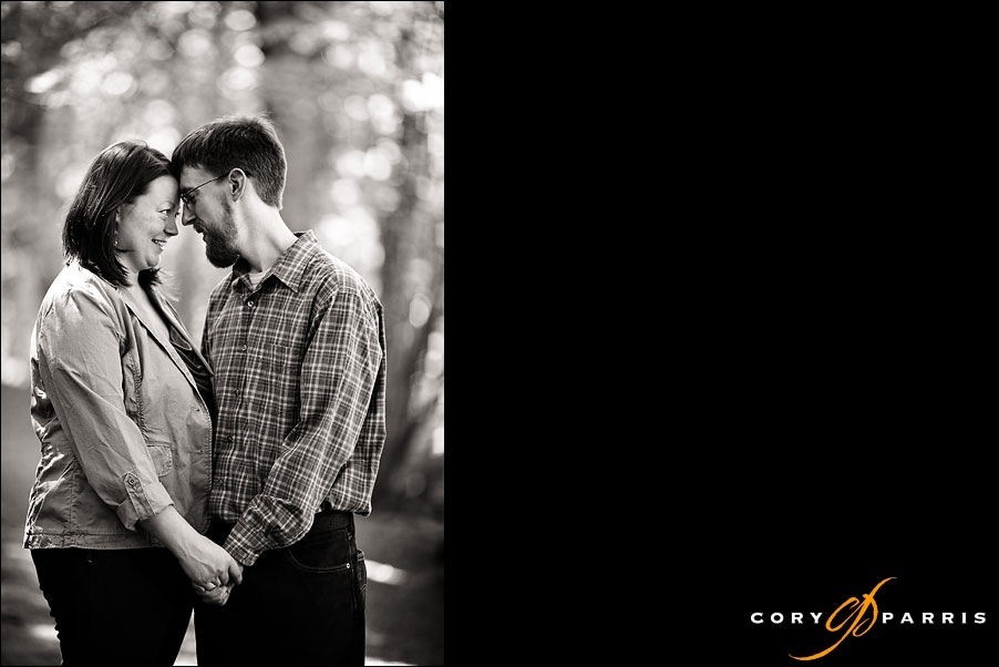 black and white engagement portrait in the woods