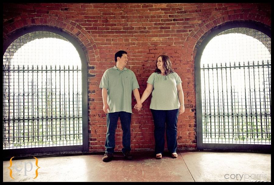 portrait of a engaged couple at the water tower at volunteer park in seattle