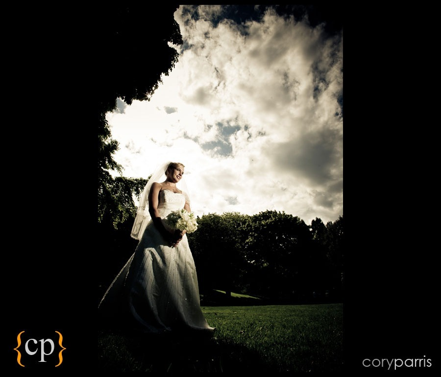 bride with dramatic sky and strobist lighting by seattle wedding photographer cory parris