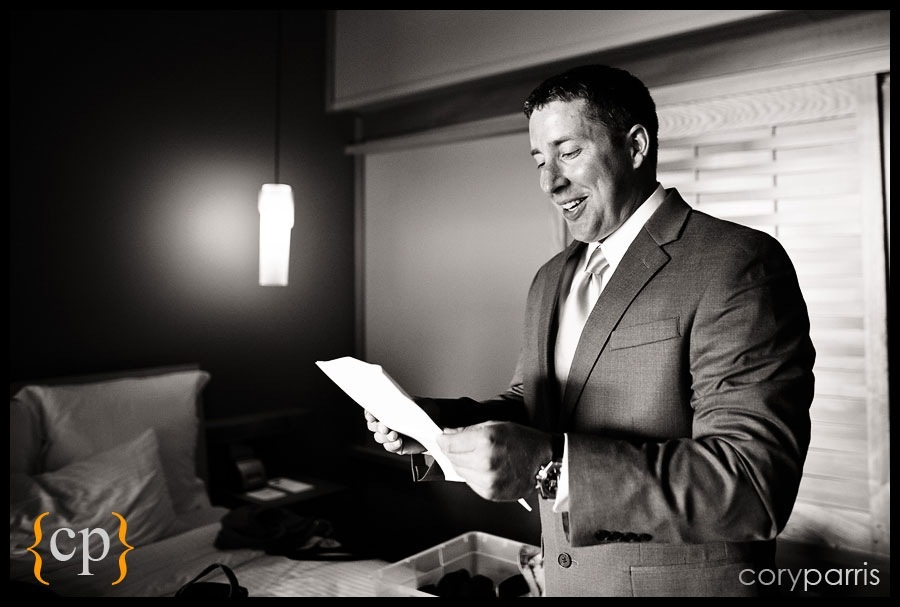 groom laughing at letter by woodinville wedding photographer cory parris