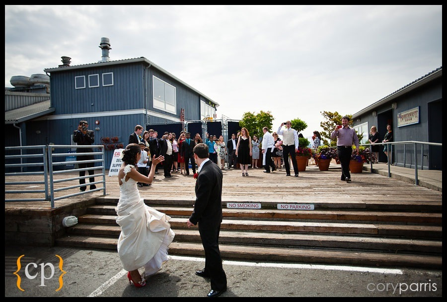 bride and groom wave goodbye to their guests at rays boathouse wedding in seattle