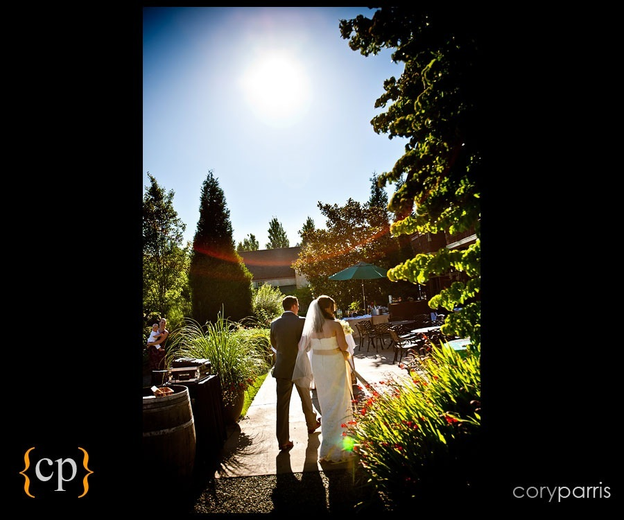 bride and groom walking away after wedding ceremony at willows lodge