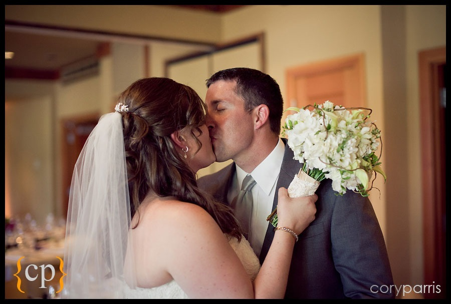 bride and groom kiss after the ceremony at willows lodge wedding