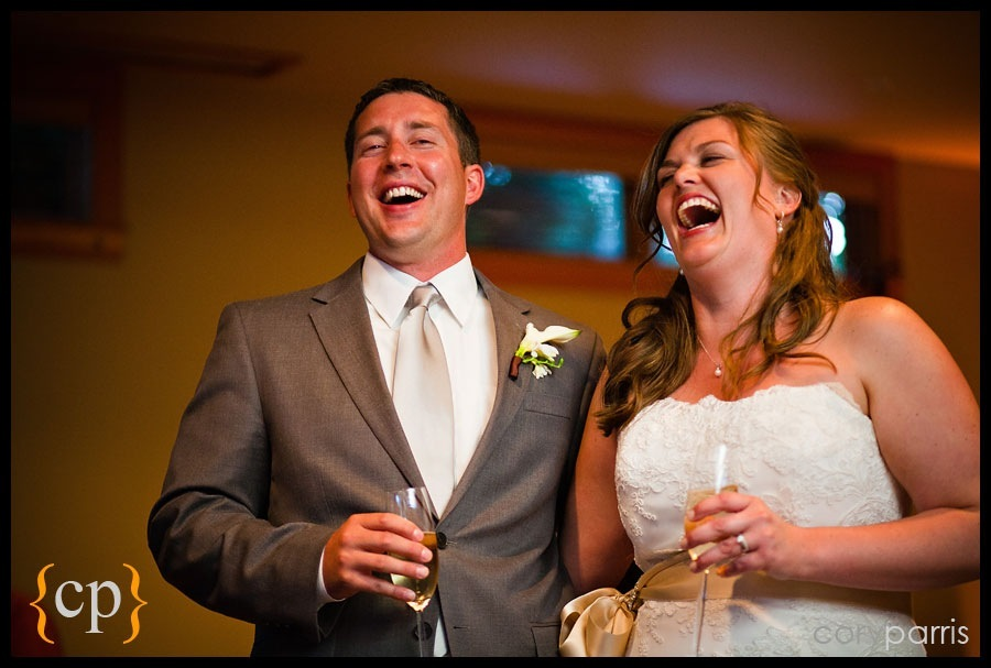 bride and groom laughing during the toasts