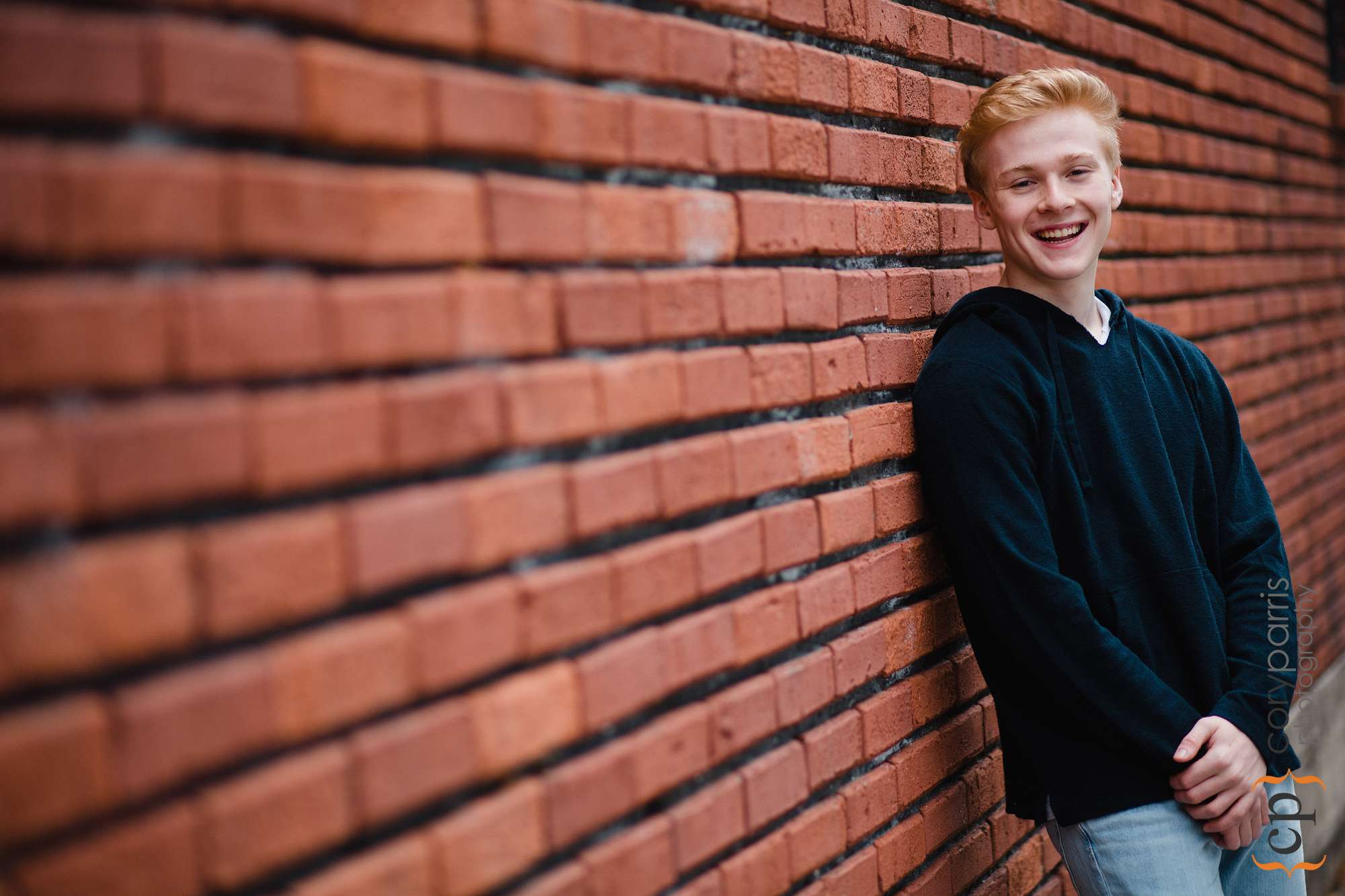 senior portrait with brick wall in seattle
