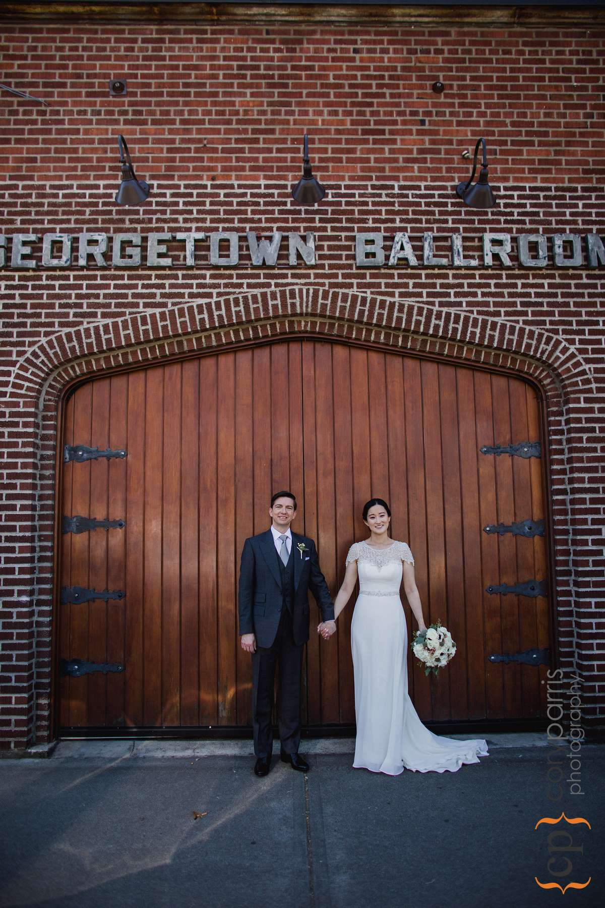 Couple portrait in front of the Georgetown Ballroom