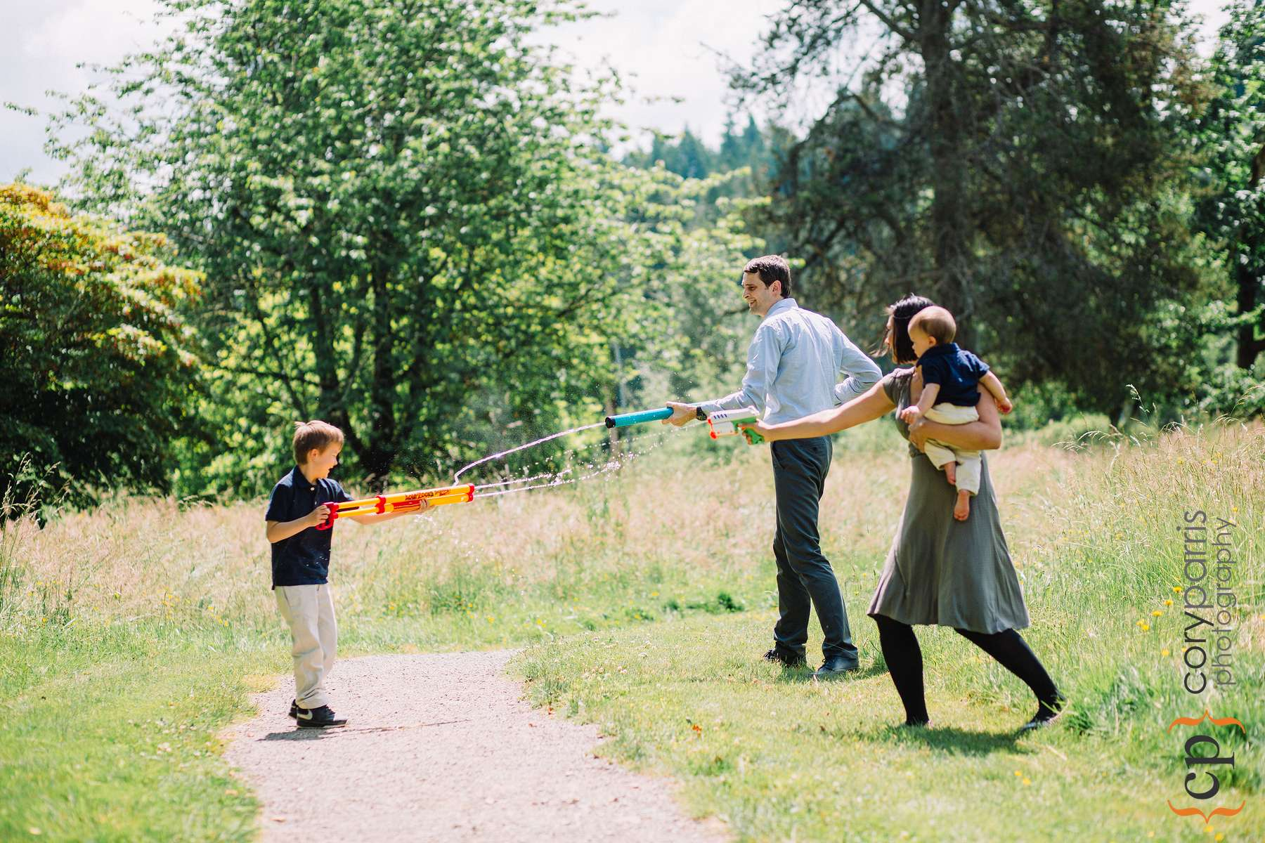 A squirt gun fight is the perfect way to end a portrait session. Even if your parents gang up on you!