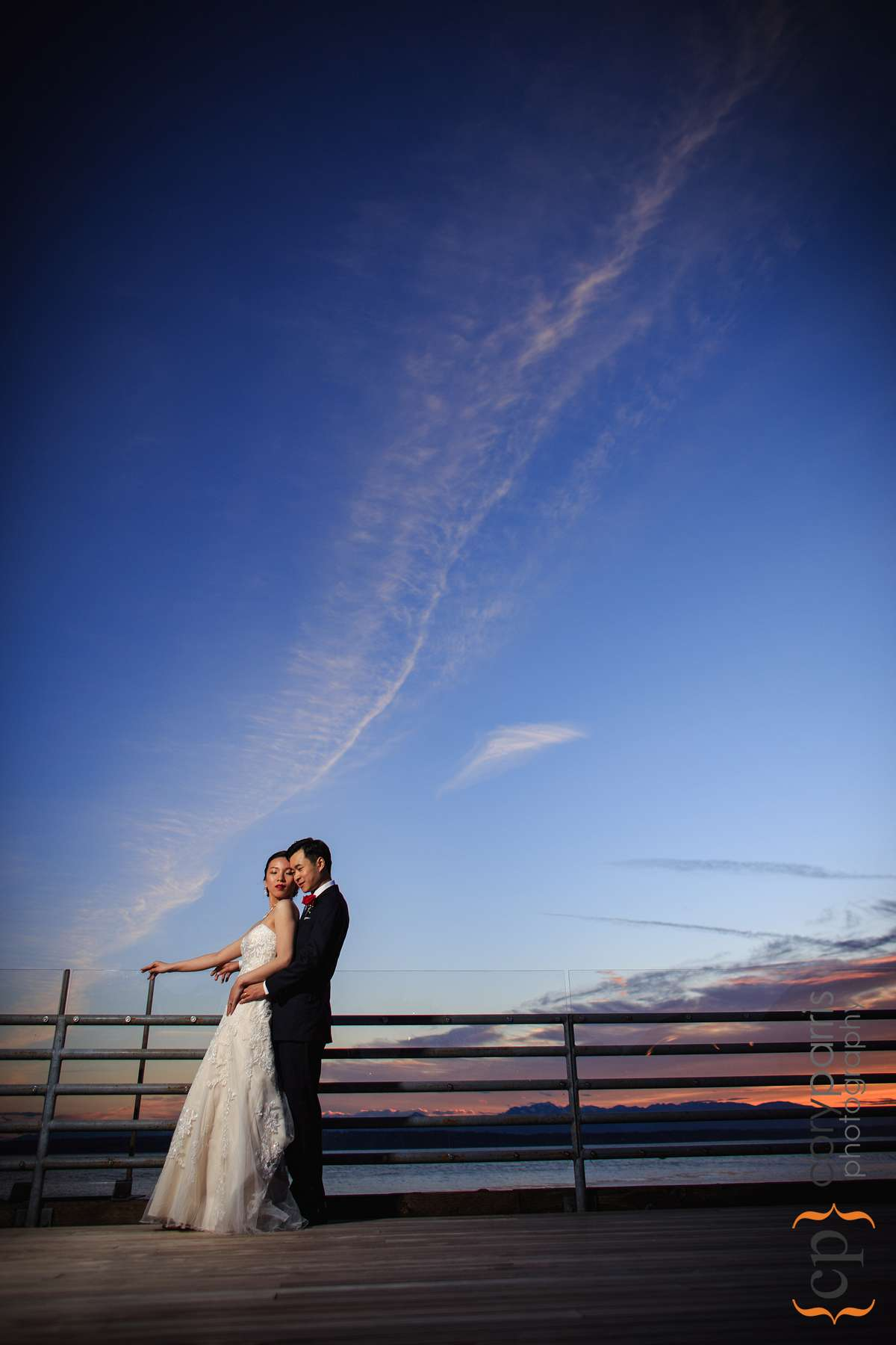 Sunset wedding photograph of Lily and Fu at Ray's Boathouse in Ballard.