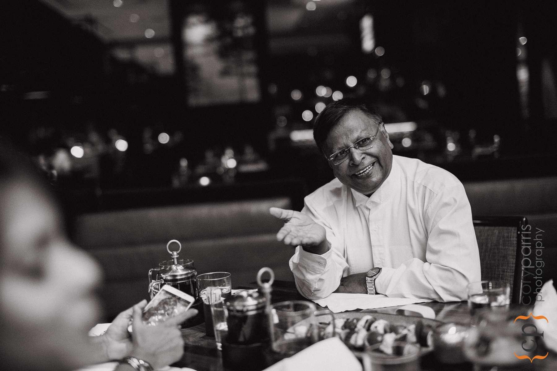 Farah's dad laughing during dinner.