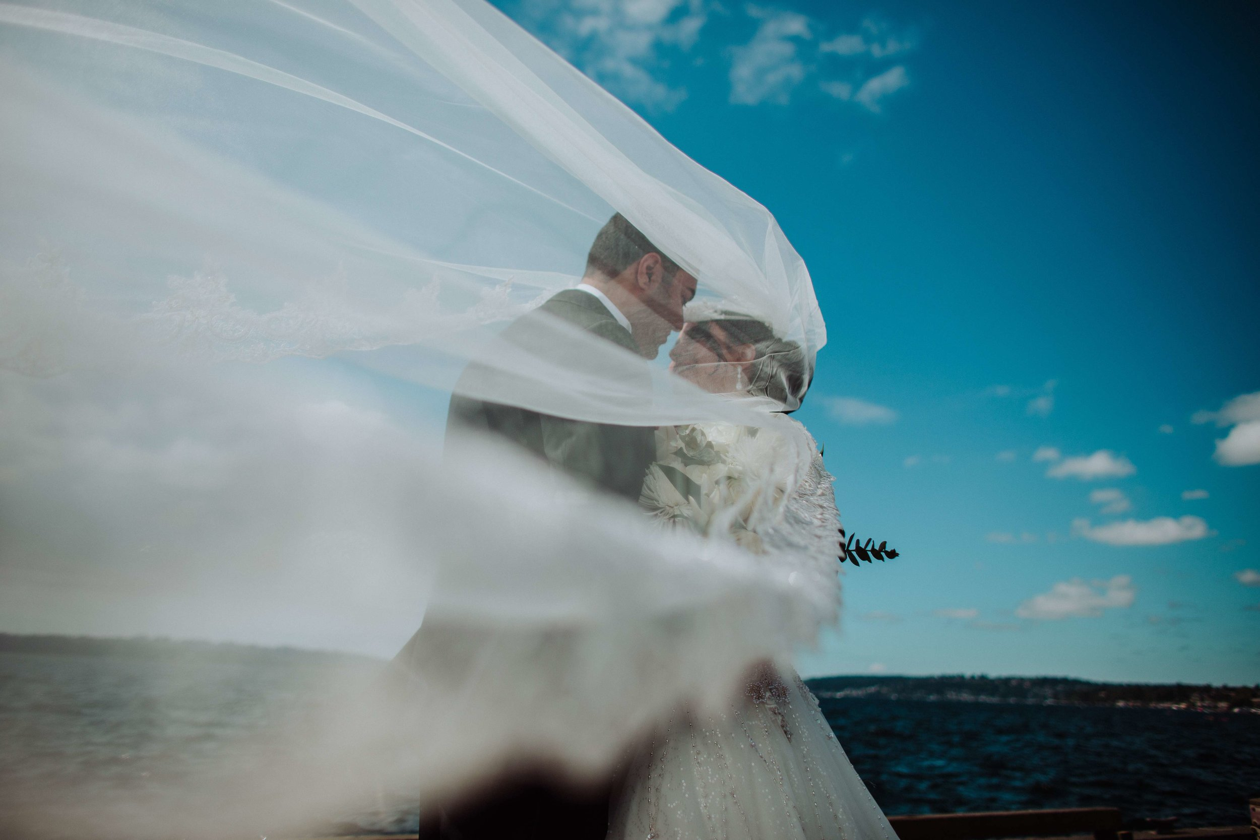 Sylvia and Michael. A wedding portrait with her veil at the Woodmark Hotel before their wedding.