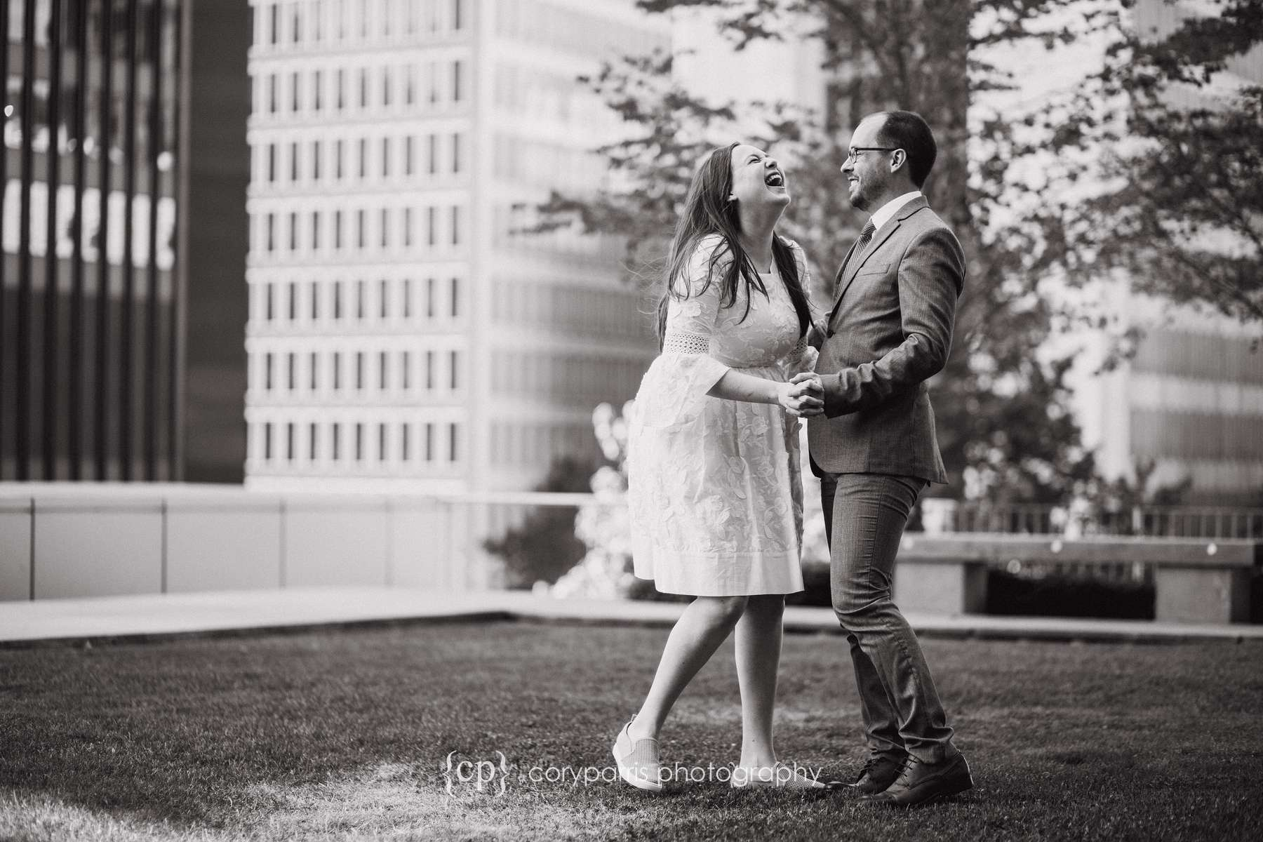 Elizabeth and Bryan laughing together before their wedding at the Seattle Courthouse