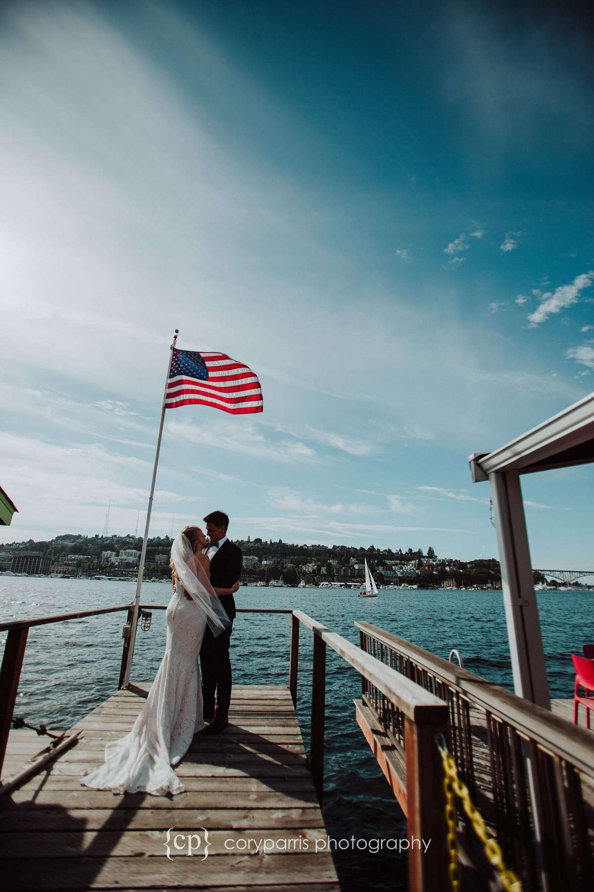 Tristan and Ben during their first look before their wedding on a dock on Lake Union in Seattle.