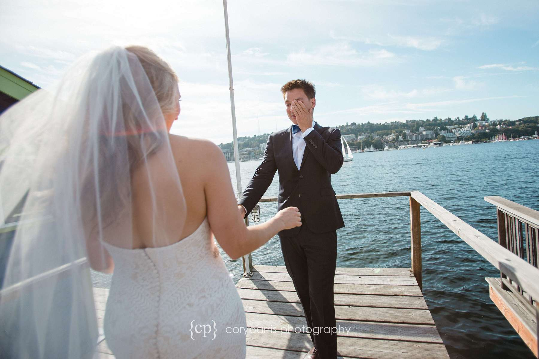 Groom crying as he sees his bride