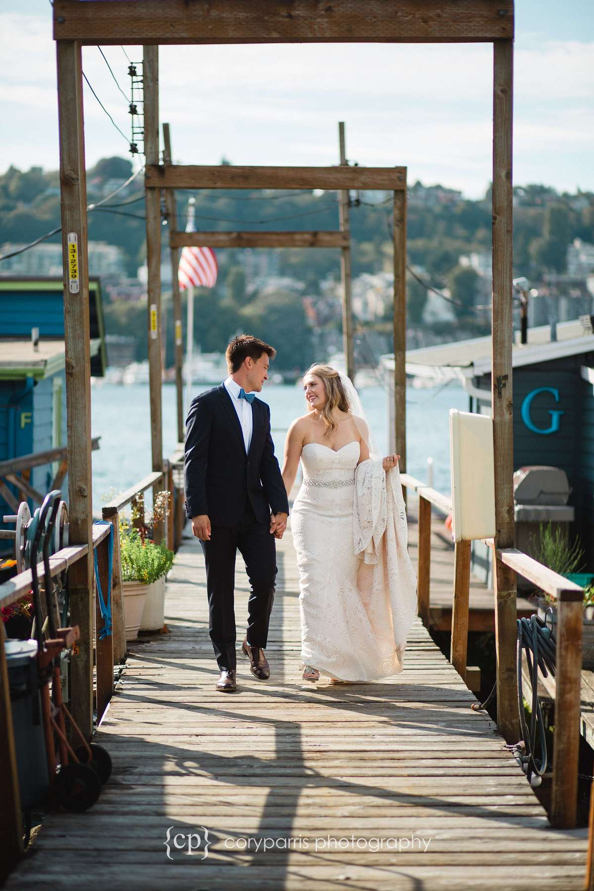 Bride and groom on a dock on Lake Union