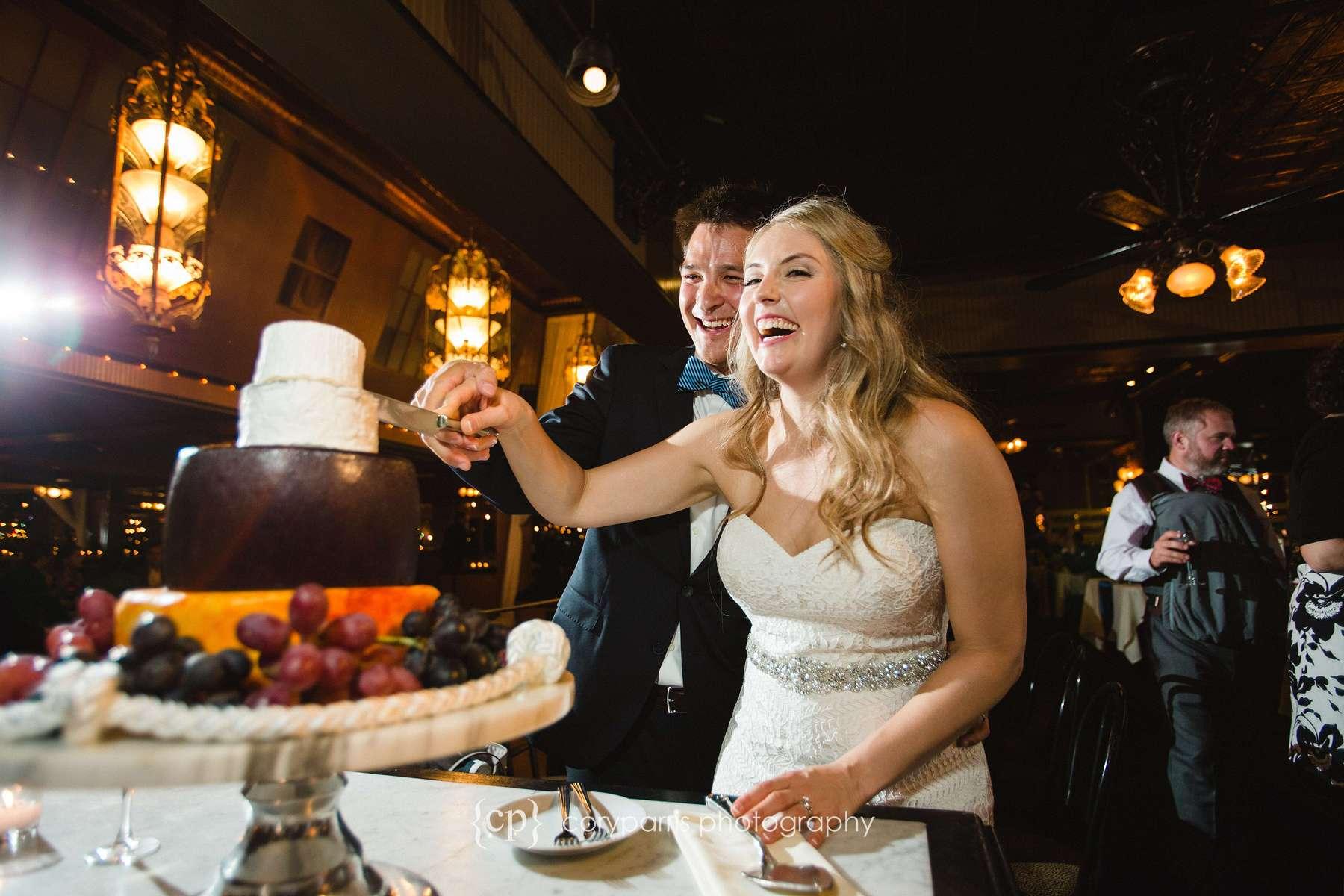 Cutting cake at Lake Union Cafe wedding
