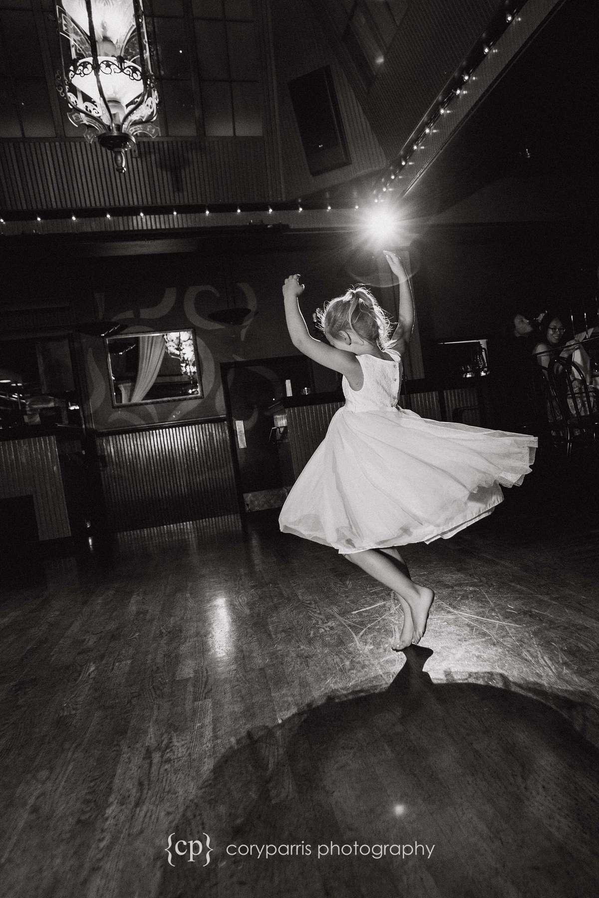 Little girl dancing at Lake Union Cafe wedding