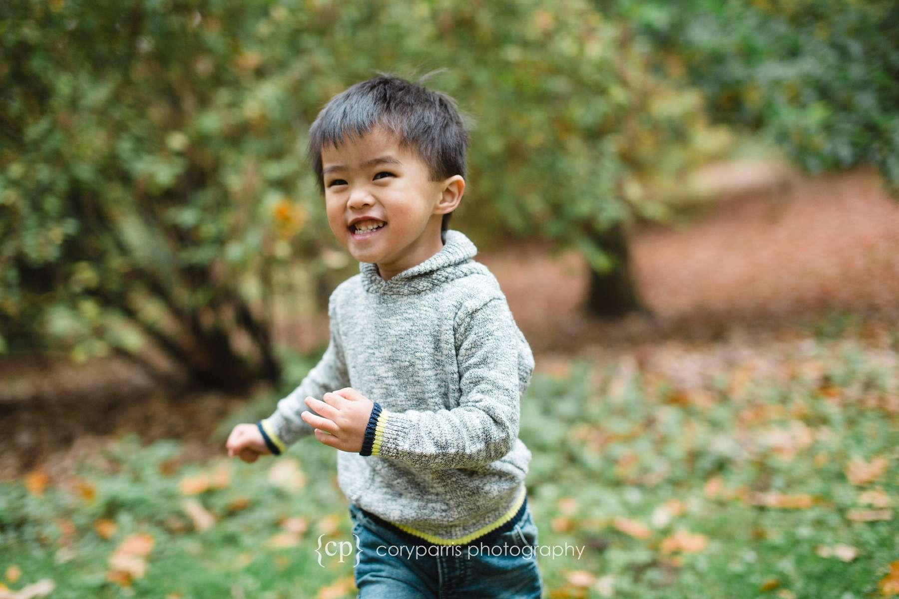 Boy running at park Seattle portraits