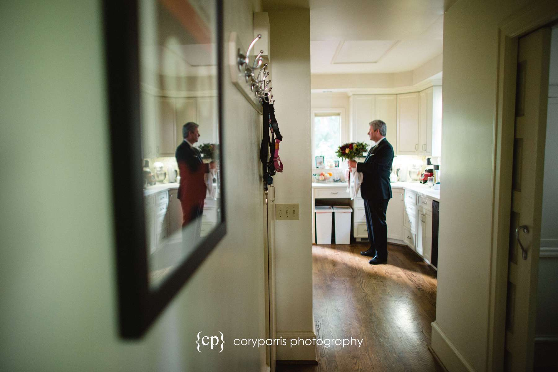 Father of the bride waiting in the kitchen with the flowers