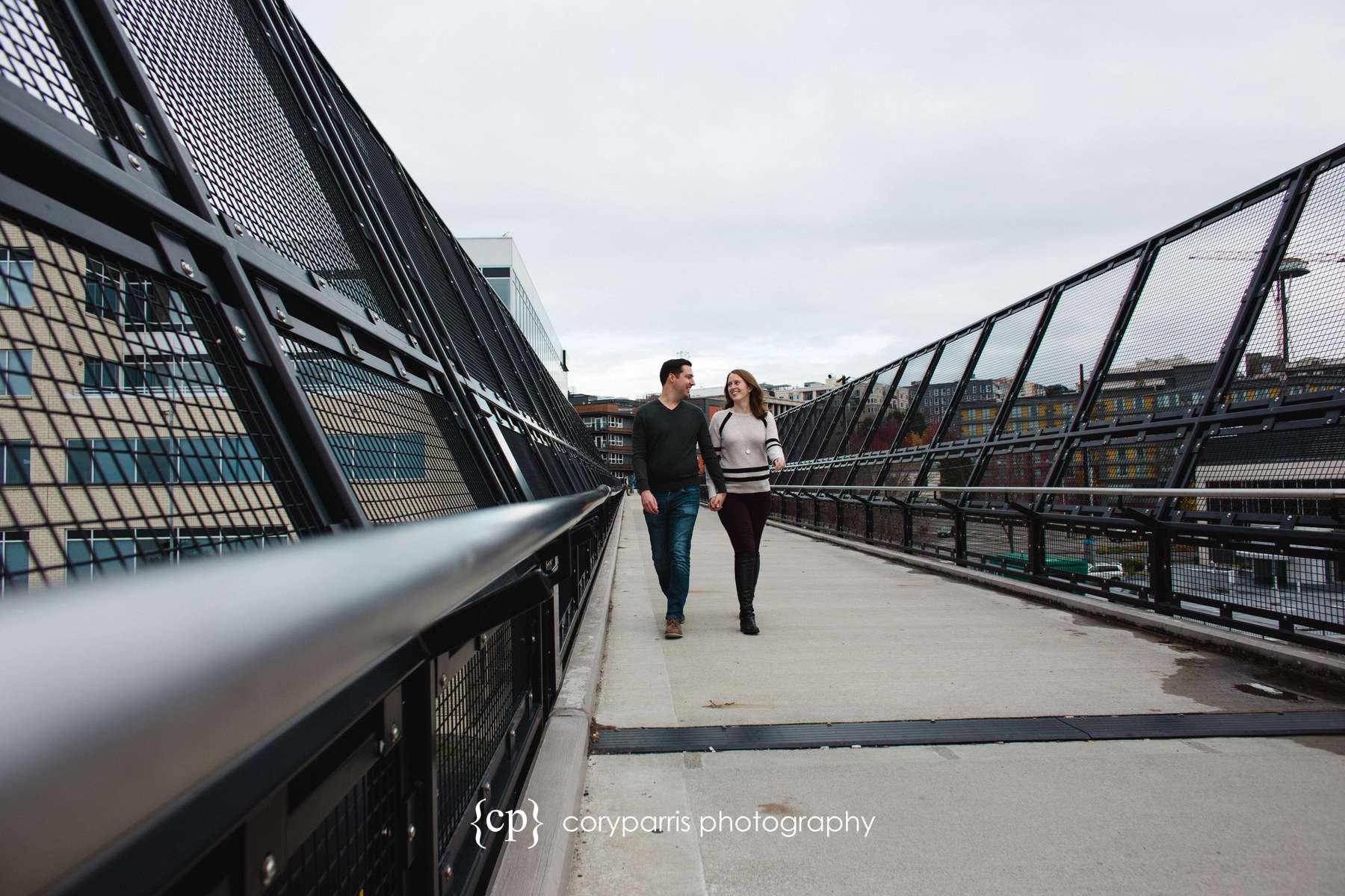 Engagement portrait couple walking seattle
