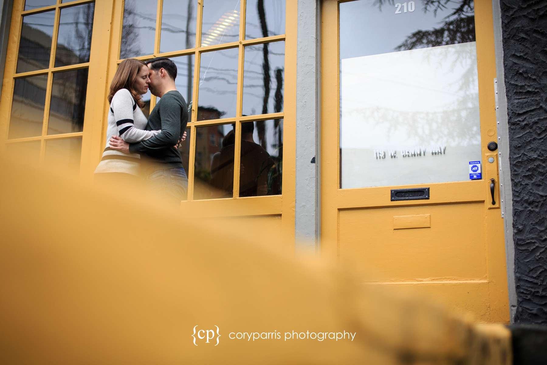 Romantic engagement portrait in Seattle with yellow door