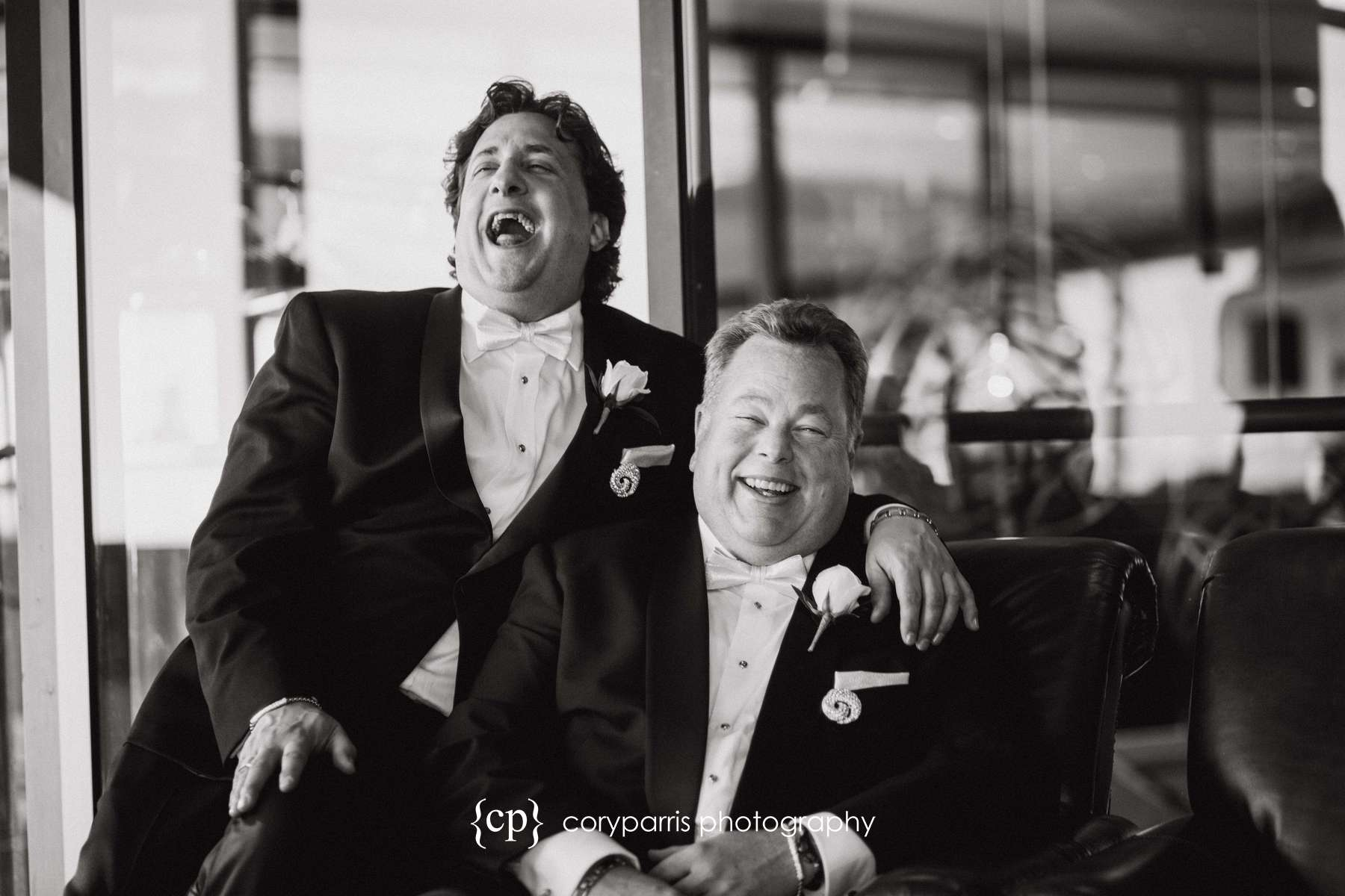 Rob and Peter laughing together before their wedding at the Columbia Tower Club.