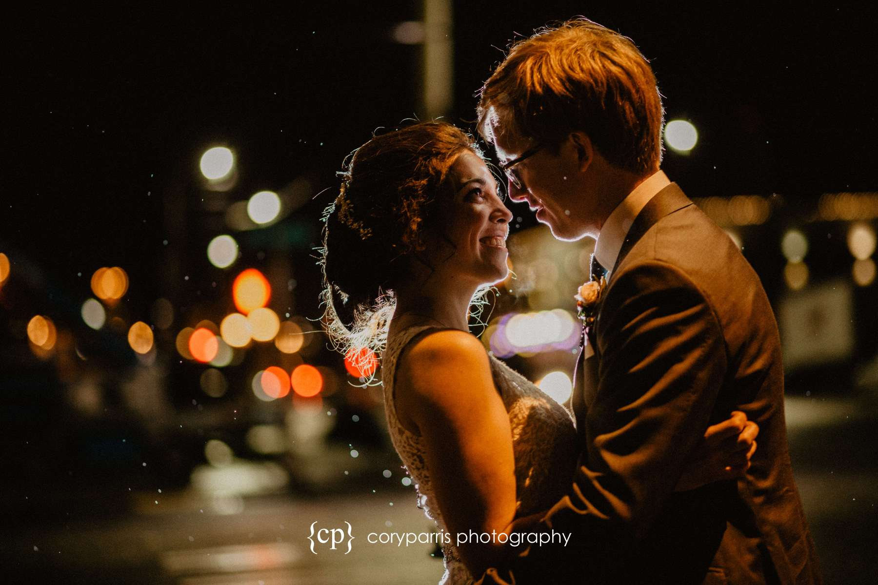 A late night portrait of Amy & Kevin on the rainy streets of Seattle outside of their SODO Park wedding reception.