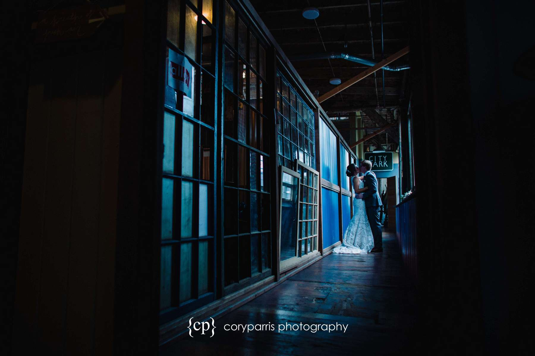 Amy and Kevin kiss for a portrait at SODO Park