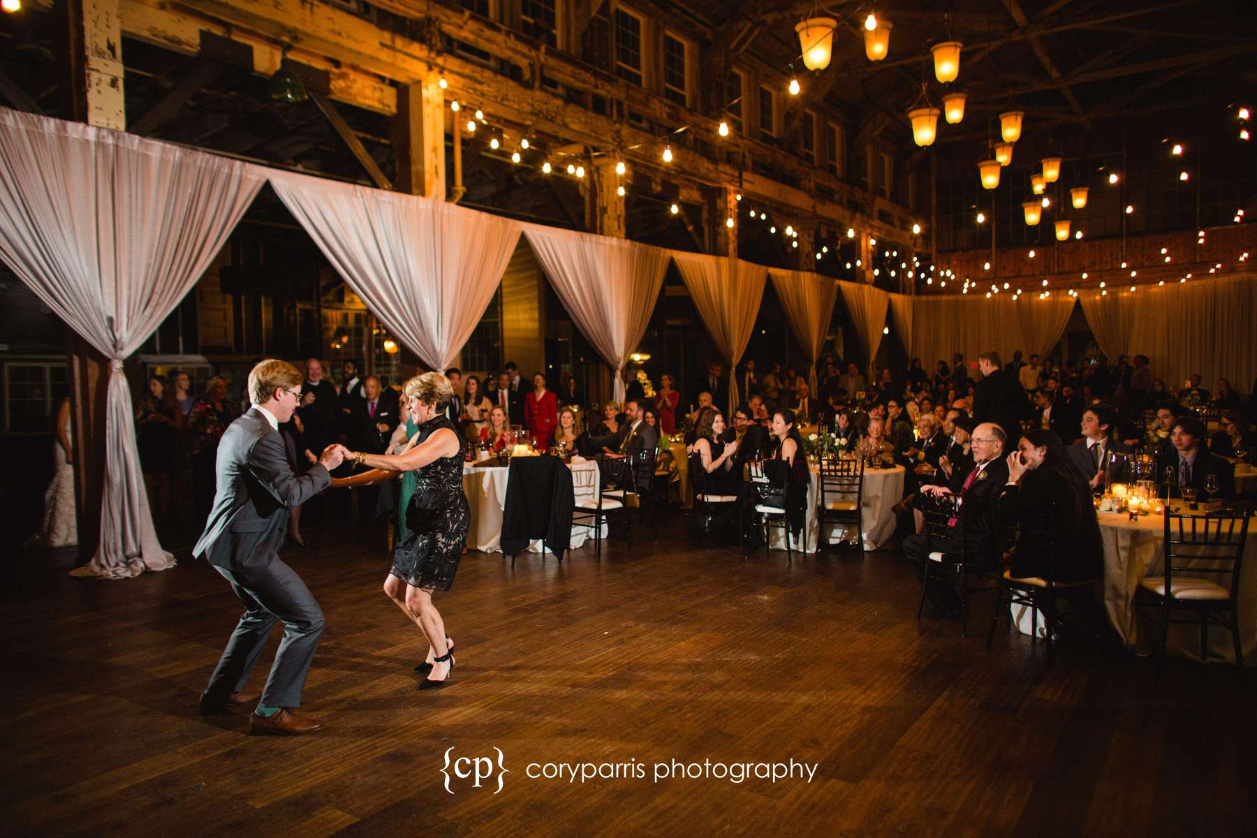 Groom and his mother dancing with the beautiful SODO Park in view
