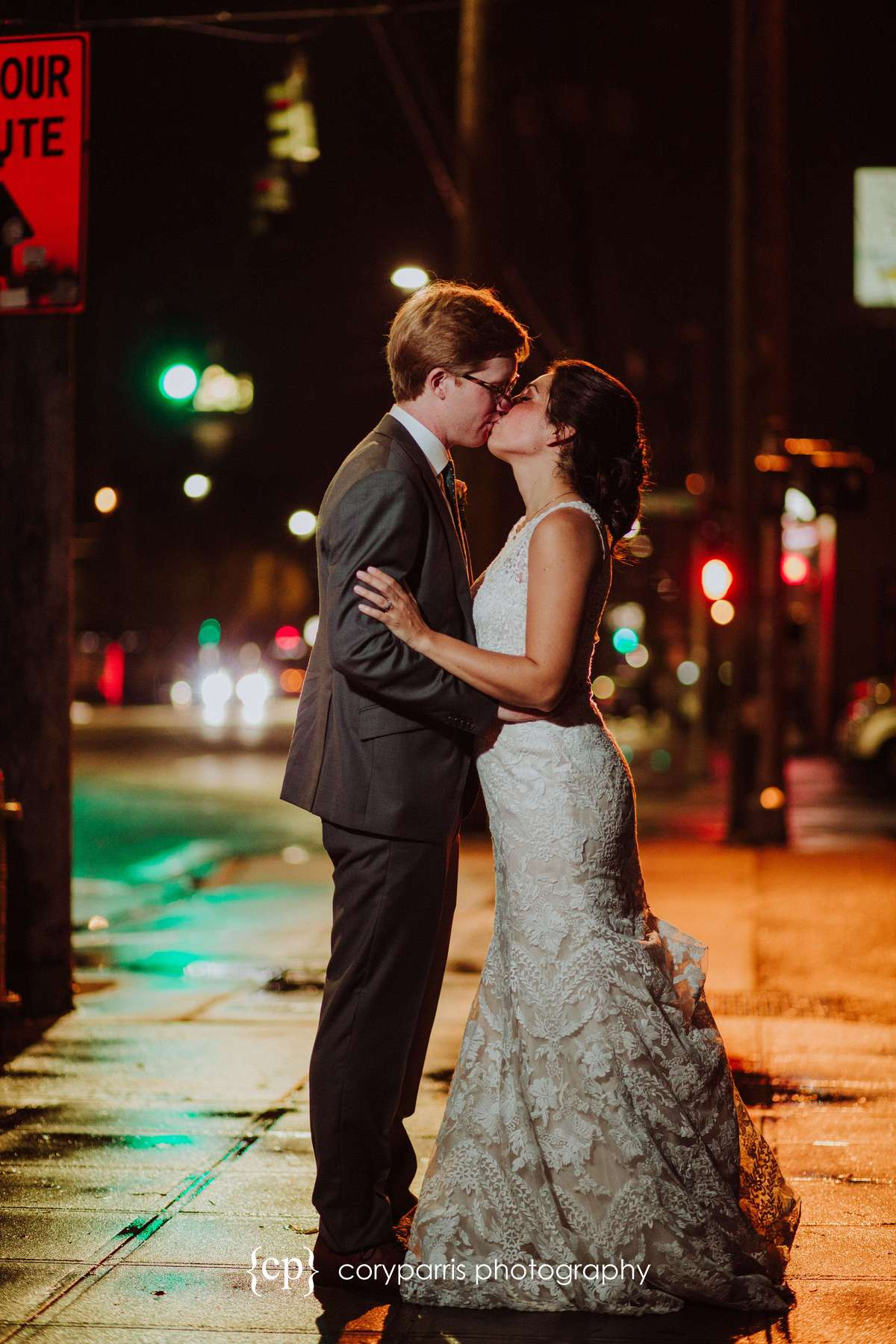 Bride and groom portrait at night on the wet streets of Seattle