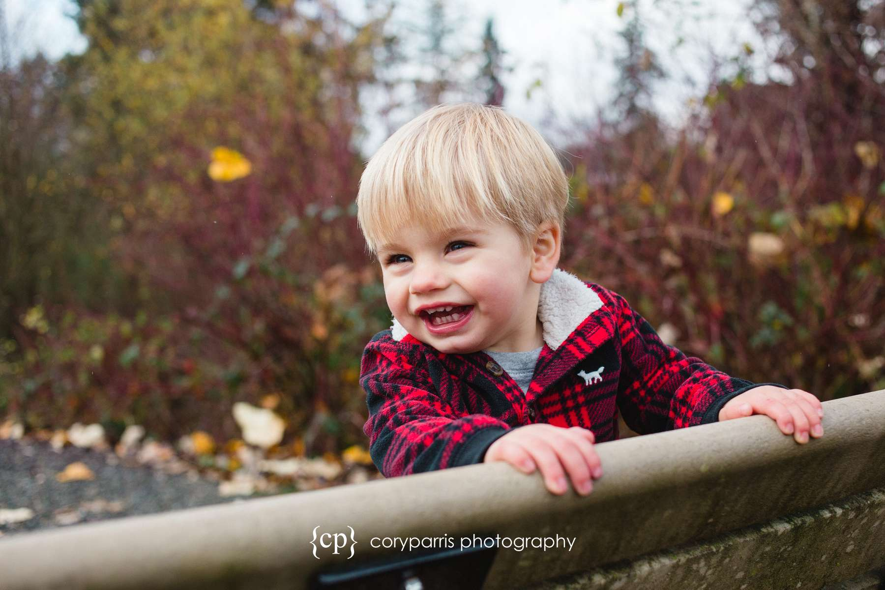 """A little boy """"posing"""" for his portrait in Bothell."""